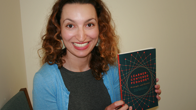 UCR Director of Teaching & Learning Dani Brecher Cook with her new book